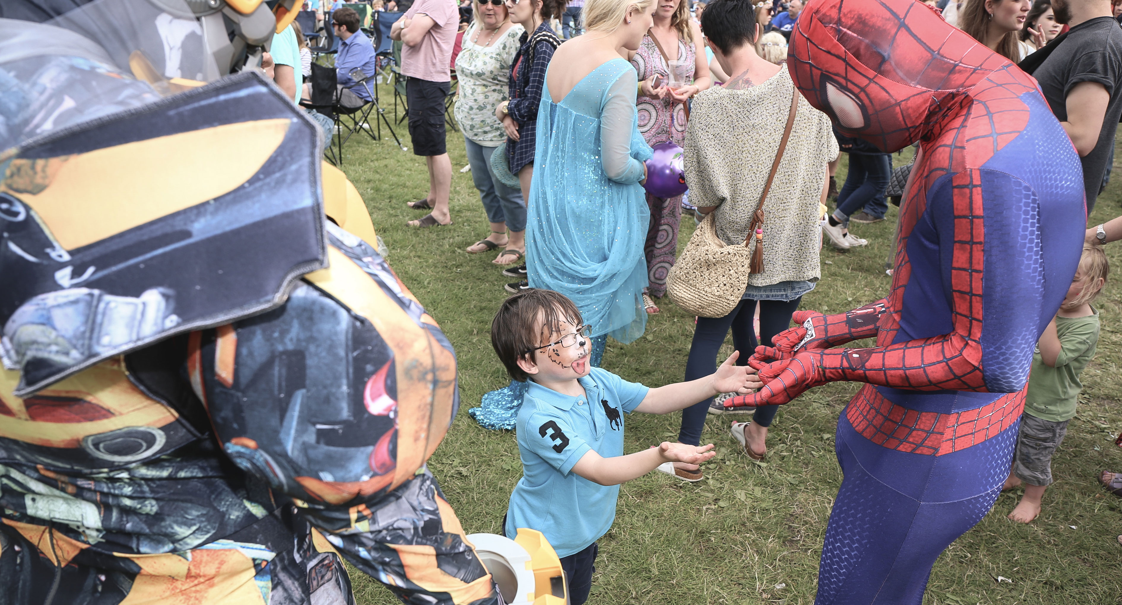 Child meeting superheroes at Corbridge Festival